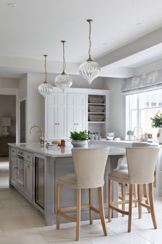 Orla glass pendant light in antiqued brass at the Cranbrook project Kitchen Pendant Lighting, Kitchen Pendants, Coin Banquette, Jim Lawrence Lighting, Fisher And Paykel Fridge, Kitchen Dining, Kitchen Decor, Dining Room, Kitchen Ideas