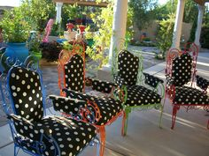 Victorian wrought iron chairs in bright colors and outdoor polka dot fabric