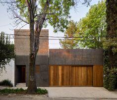 Modern concrete home in Mexico City unfurls around two courtyards - Curbedclockmenumore-arrow : The T-shaped house is arranged around two courtyards