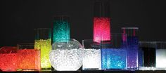 For Centerieces: Clear Water Pearls (water holding vase gems) Come in colors too, or can be lit with submersible led lights