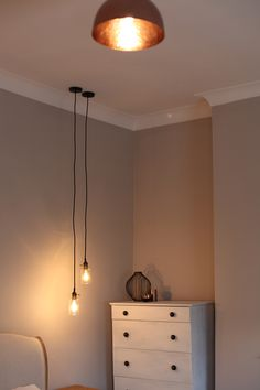 Rum Caramel 5 Dulux works well with the #copper lighting in this bedroom #henryfix