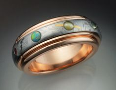 each planet is a different gem ... hommina hommina.    14k rose gold Nine Planets ring with by Metamorphosisjewelry, $3600.00