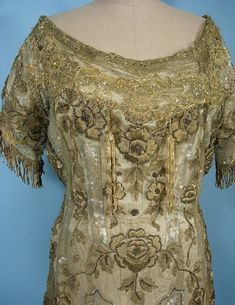 c. 1910 Trained Edwardian Evening Gown of Gold Netting with Gold Beads, Clear Sequins and Gold Bullion Embroidery over Ivory Silk. The ivory silk underdress is in surprisingly good condition. Detail