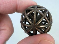 """A wonderful """"spherical thing"""", impossible to produce without 3d printing. It's super fun to play with it in your fingers, leaving it on your desk it will attract everyone curiosity :) Available in different materials."""