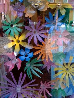 Water bottles cut into flowers! Love this idea...