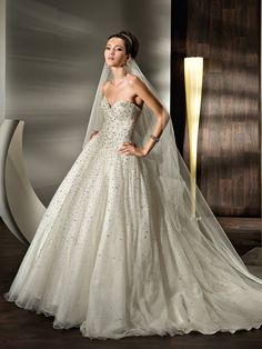 Demetrios 528Beaded Sparlking tulle, Strapless with a Basque waist, full, A-line skirt, Lace-up back and attached train