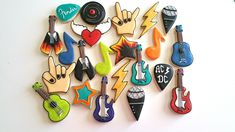 Awesome combo of Rock n roll cookies You can pick a custom dozen Guitars Stars Rock fingers Angel hearts Guitar pics Microphone Lightning bolt Vinyl record Shipping within the United States only. My goal is to create custom cookies to make any event memorable. I take great pride and care