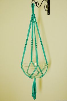 Simple design, would be quick to make. (Pinner said: Hand Crafted Macrame Plant Hanger- Turquoise. $11.99, via Etsy)
