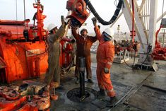 Kuwait, OPEC's fourth-biggest member, is considering cuts to its oil production capacity targets, in large part because mounting concern about climate change will constrict demand for fossil fuels. Oil Rig Jobs, International Energy Agency, Bloomberg Business, Capital Expenditure, Gas Company, Drilling Rig, Oil Industry, About Climate Change, Environmental Issues