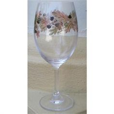 The Autumn Wine Glass has oak leaves and acorns in fall shades of green and brown that ring this wine glass. This 16 ounce hand painted Autumn Wine Glass is captures the colors and natural beauty of fall. Use the Autumn wine glass all through the fall and for Thanksgiving. Experience the enjoyment of this gorgeous hand painted autumn wine glass. The artist resides in Vero Beach Florida and hand paints each glass individually so no two are absolutely identical. Although the paint is durable