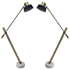 Impressive Pair of Brass Floor Lamps by Reggiani | From a unique collection of antique and modern floor lamps  at http://www.1stdibs.com/furniture/lighting/floor-lamps/