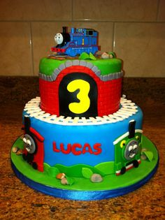 Thomas the train cake! Yellow cake with vanilla rainbow sprinkle buttercream, covered and garnished with fondant.