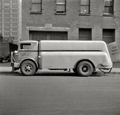 """March 1943. """"New York, New York. Department of Sanitation street flushing sprinkler truck."""