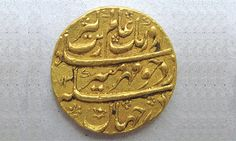 Gold coin from Mughal Emperor Aurangzeb Alamgir's period. According to DOAM, the text reads 'Issued with King's seal for the entire World'.