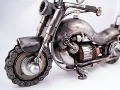 One of a kind welded shot gun sculpture. I welded This piece from all recycled metal. Steampunk Motorcycle, Motorcycle Gifts, Motorcycle Art, Chopper, Royal Enfield, Glass Showcase, Mechanical Art, Motorcycle Manufacturers, Old Motorcycles