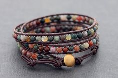 ♥100 % HAND WOVEN IN THAILAND This is leather wrap bracelet made with brown genuine leather cord weaved together with fancy jasper stone . Closure using large size brass bead with 3 step loop for size adjustment . ♥ lightweight and comfortable to wear ♥ Bracelet measures 23 inch long and