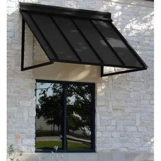 The Houstonian Metal Standing Seam Window Awning provides great curb appeal. It is made from structural aluminum and stainless steel hardware and has been engineered and tested to withstand serious wind and snow loads. Awning Over Door, Diy Pergola, Pergola Ideas, Pergola Kits, Black Pergola, Pergola Shade, Diy Awning, Pergola Plans, Patio Ideas