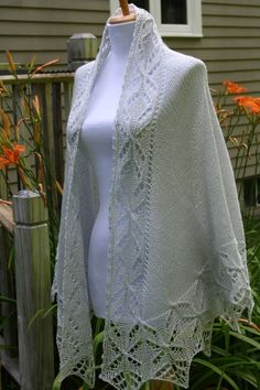 This shawl is elegant; this shawl is timeless; this shawl has a unique design. The secret is in non-traditional construction: the flower design goes around the neck and front sides, repeats itself on the back of the shawl as well as on the lower lacy border. BUT: no sewing or grafting of a top lace border is needed! This semicircular shawl is worked in one piece!  Materials Yarn: Fingering yarn, about 231 yards/50 gram ball, 3 balls Tools: circular needles, US 7 (4.5 mm) Gauge: 5-6 st. in 1…