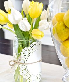 This easy centerpiece will look great on your table all season long—all you have to do is change out the flowers every few days. Take two round paper doilies, wrap them around the Mason jar, and secure with a burlap string. Fill the jar with colorful and in-season blooms, like these yellow and white tulips.