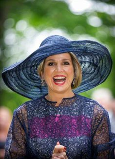 Queen Máxima, May 27, 2015 in Fabienne Delvigne | Royal Hats: Made of light straw that appears to be sewn together in long strips, the hat is simply trimmed in a wide swath of rough edged navy straw that lies on top of the brim. This hat is all about texture and easy movement.