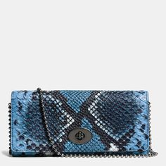 A detachable Coach beadchain converts the well-organized Slim Envelope from wallet to mini bag—wear the chain long as a crossbody, or double it to wear as a shoulder bag. This particularly fetching version is finished by hand in python-embossed leather with dramatic texture, ready to be popped into a handbag by day or taken out at night.