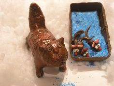 Handmade chocolate cat with the cat litter and almond food.