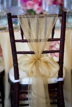 .A great way to use an organza sash. Gold organza chair sash