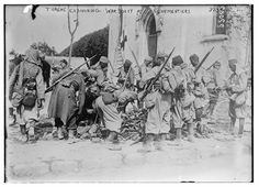 """WW1: Algerian tirailleurs (infantry soldiers) serving with the French Army examine war booty at Chauconin-Neufmontiers, France, 1914. The original handwritten caption of the photo refers to them as """"Turcos,"""" a common term in those days referring to the Ottoman Turks, who still extended their authority over parts of the Middle East and were associated by Europeans with any Muslim combatant."""