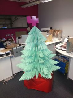 Origami Christmas Tree. 1200 A3 sheets of green paper, all ready for some origami decorations