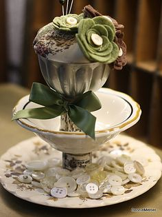 This is a fave of mine~old dishes made into a three tier cutie, to hold scrappy stuff, buttons etc. The top tier is a jello mold from long ago.