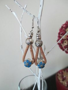 Check out this item in my Etsy shop https://www.etsy.com/listing/249877911/cork-yarn-earrings-with-metal-beads-and