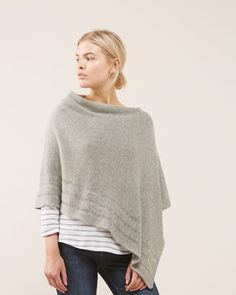 This cosy poncho is made from a virgin wool and viscose blend with a touch of cashmere for a luxe finish. An easy, relaxed fit, features include ladder stitch detailing at the hem and a centrefront seam. Layer this versatile knit over pieces from your casual wardrobe.