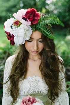 This gorageous floral crown, designed by Angela Marie Events, was made with high-quality silk flowers from Afloral.com. Why silk flowers? They can be made long before the wedding and kept long after. Afloral.com silk flowers look and feel like the real thing and are so easy to use for your DIY floral crown designs.
