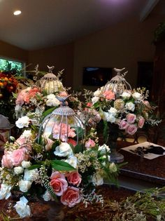 My beautiful bird cage centerpieces for my wedding. The cages were a special order from Atlanta (I live in Oregon) and the flowers were all local. Plus they were designed by a very special person that i consider my second Mom.