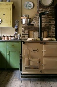 Would kill for an old wood stove.... house would probs fall down from the weight