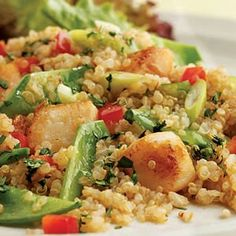 INGREDIENTS 12 ounces dry sea scallops, cut into 1/2-inch pieces, or dry bay scallops (see Note) 4 teaspoons reduced-sodium tamari, or soy sauce, divided 4 tablespoons plus 2 teaspoons canola oil, divided 1 1/2 cups quinoa, rinsed well (see Tip) 2 teaspoons grated or minced garlic 3 cups water 1 teaspoon salt 1 cup trimmed and diagonally sliced snow peas, (1/2 inch thick) 1/3 cup rice vinegar 1 teaspoon toasted sesame oil 1 cup thinly sliced scallions 1/3 cup finely diced red bell pepper 1/4…