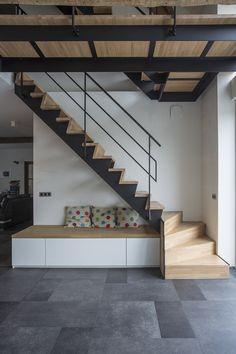 Metal and wooden staircase with seating area.