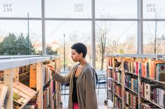 Young woman browsing for books in a library