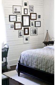 Fill an art wall for less. Mix a jumble of different-size art prints, photos and printed quotes, all in black and white, on a single gallery wall. Cut-up art books, postcards and snapshots are all very affordable ways to build this look, and the simplest frames will look cohesive in black and white.