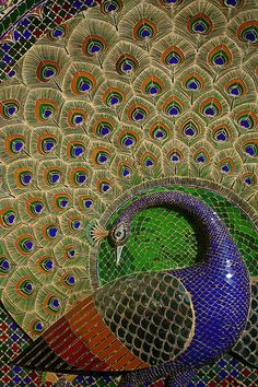 Mor Chowk (Patio of the Peacocks), in the City Palace of Udaipur, India. Constructed by Sajjan Singh in century XIX. A total of 5,000 pieces of mosaic of green, blue, crystal and gold, as well as concave mirrors, evoke the elegant movement of the birds that are the symbol of the Rajasthan.  GORGEOUS...
