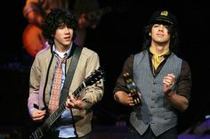"Nick and Joe Jonas of the Jonas Brothers perform onstage on CBS News' ""The Early Show"" at the Hard Rock Cafe on March 21, 2008 in New York City."