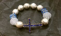 Unfailing Love Cross Bracelet Blue, White and Silver. $18