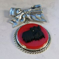 Classical Vintage Silver Bow with Red Bakelite and by gibscot, $79.00
