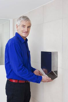 The Dyson Airblade V hand dryer is 60% smaller than the original, but just as powerful.