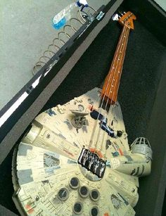 Millennium Falcon Guitar! if we could use this as a prop for The Wedding Singer musical my school is doing . . . . :)