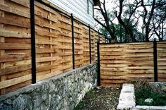 Cedar and Iron Basket Weave Fence Country Fences, Rustic Fence, Backyard Fences, Backyard Landscaping, Backyard Ideas, Outdoor Glider, Privacy Walls, Privacy Screens, Fence Doors
