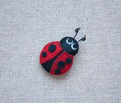 This cute ladybug brooch with tiny red heart on the back is made of felt and stuffed with poly-fill. It will arrive to you gift wrapped. Size: 6 x 5cm