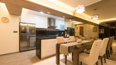 Open concept kitchen and dining area worth bronze mirror feature. Modern interior concept, luxe, elegant feel. A project at Punggol, 5rm BTO HDB. - Samuel, Unity
