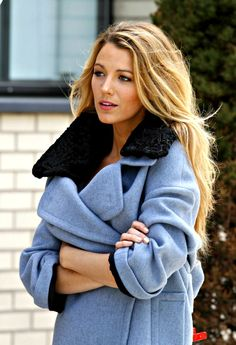 that color is fabulous w/the dark fur collar... this girl can do no wrong lately when it comes to fashion...