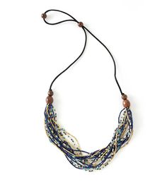 This Multi-Strand Necklace combines 16 Zulugrass strands in calming blue and sand tones. Each necklace features beautiful fallen acacia wood beads and is strung on a black satin cord that can be adjusted to lengthen or shorten the necklace's drape. African Beads Necklace, African Jewelry, Tribal Necklace, Multi Strand Necklace, Beaded Necklace, Strand Bracelet, Handmade Necklaces, Handcrafted Jewelry, Blue Beads